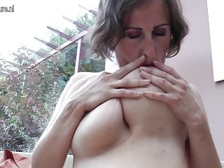 Big breasted mature mother playing alone