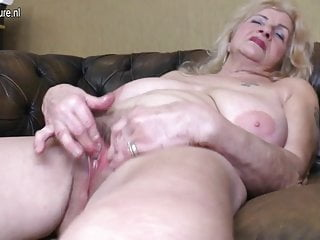 Naughty granny playing with her hairy pussy