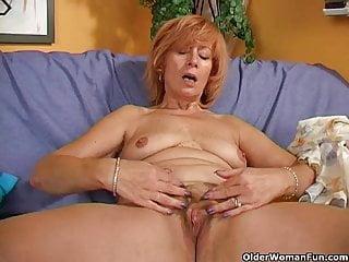 Redheaded granny masturbates her hairy pussy