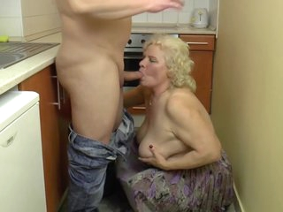 Busty Hungarian Granny Kitti fucks in the kitchen