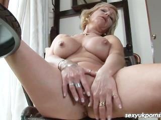 Mature British pornsatr Jane Bond pussy play in the study
