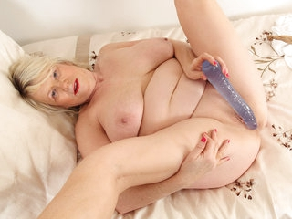 Busty grandma Elle gets naughty in nylons