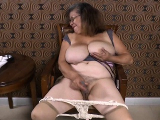 OmaGeil Busty Latin Lady Playing With Herself