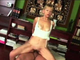 A slutty blonde granny masturbates passionately before