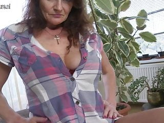 Big breasted granny getting wet and wild