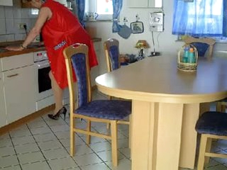 Granny fisted and banged on a kitchen table