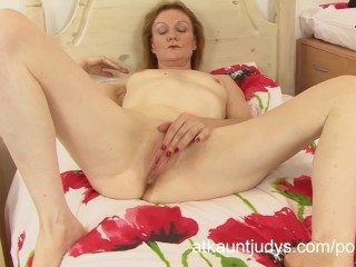 Clare Cream pleasures her pink pussy.