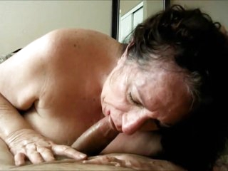 Brunette grandma sucking a young shaft