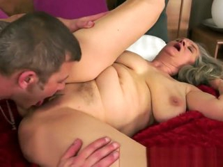 Busty grandma in lingerie fucked by young guy