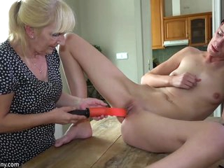 OldNanny Old lady and cute girl masturbating with dildo on the desk