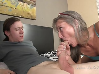 Small titted, mature lady is fucking a younger man while giving him amazing sex lessons