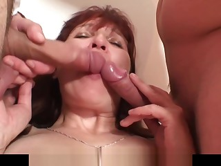 Poker playing redhead granny double penetration