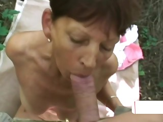 Short Haired Babe Blowing Cock