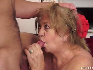 Big old grandma massages her boy toy