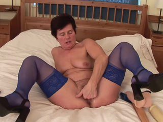 Horny granny, Ibolya took off her animal printed dress and started drilling her hairy pussy