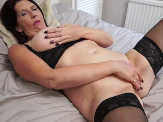 Elderly brunette with big, saggy tits took off her clothes and started masturbating in her bed