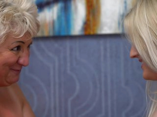 Frisky teen lesbian, Karley Grey is making love with a blonde granny and enjoying it a lot