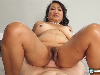 Asian granny, Mandy Thai is fucking much younger guys and teaching them some very hot tricks