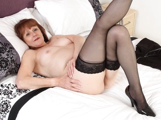 British gilf Pandora gets busy with her dildos
