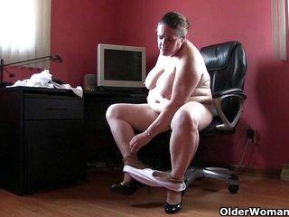 Old lady masturbates at the office